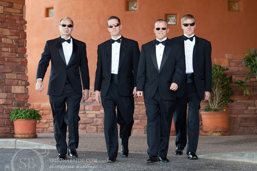 men in tuxedos wearing sunglasses